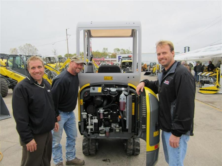 (L-R): Josh Anforth of Wacker Neuson, Don Rowden of Northern Illinois Pool and Ken Polheber of Burris Equipment look at the engine of this Wacker Neuson 1404 compact excavator.