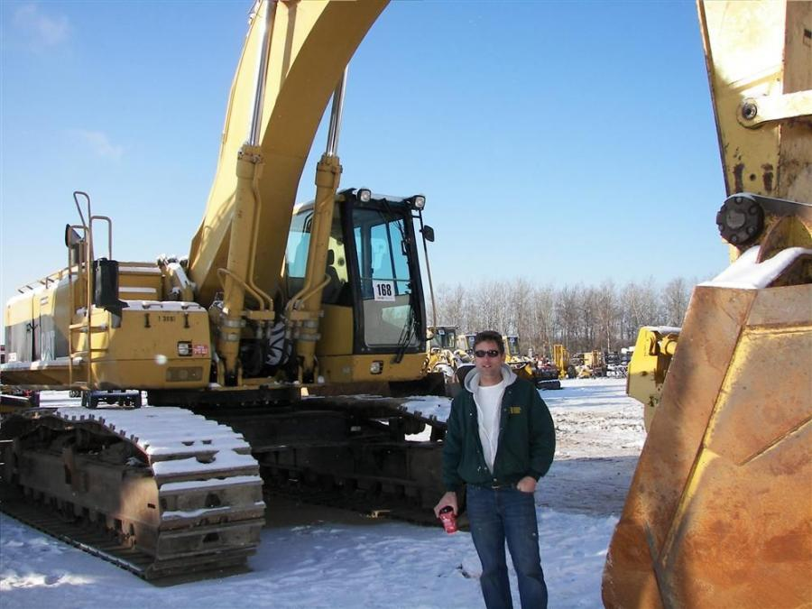 Standing next to this Cat 365 BL excavator is Larry Beach of Larry Beach Construction, North Branch, Minn., who mostly works on new home construction.