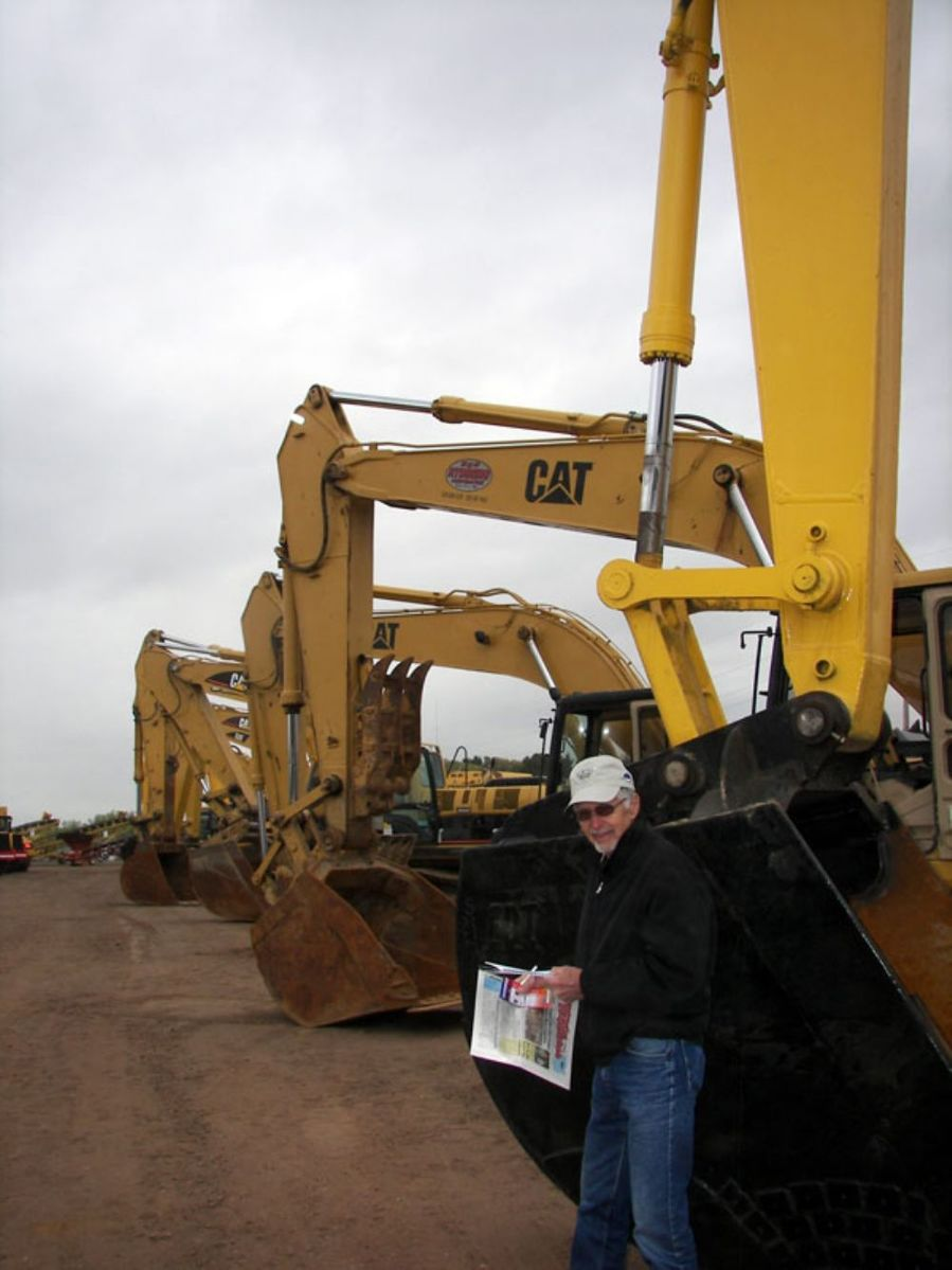 Jim Stewart of Stewart Companies, Hanover, Minn., is looking for excavators and checking out pricing, like on this Komatsu PC300LC excavator.