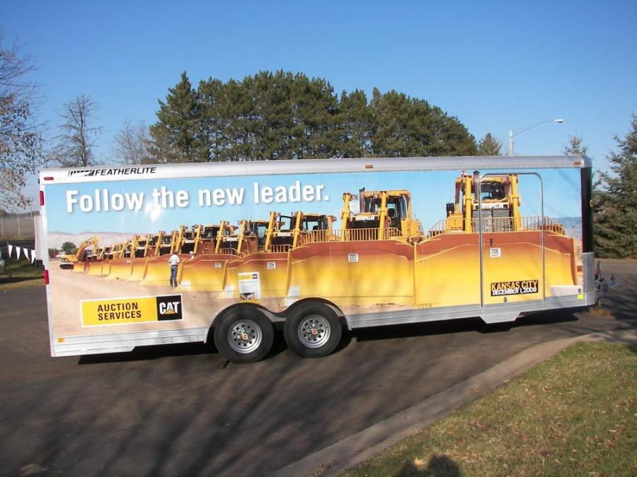 Cat Auction's on-site trailer welcomes bidders to sale.