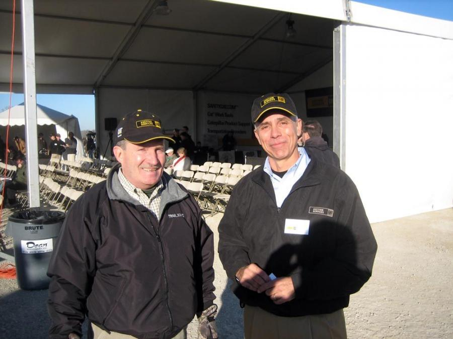 Charlie Baer (L), corporate used equipment manager of Ziegler Cat, meets with Rick Albin, Cat Auction Services president and CEO.