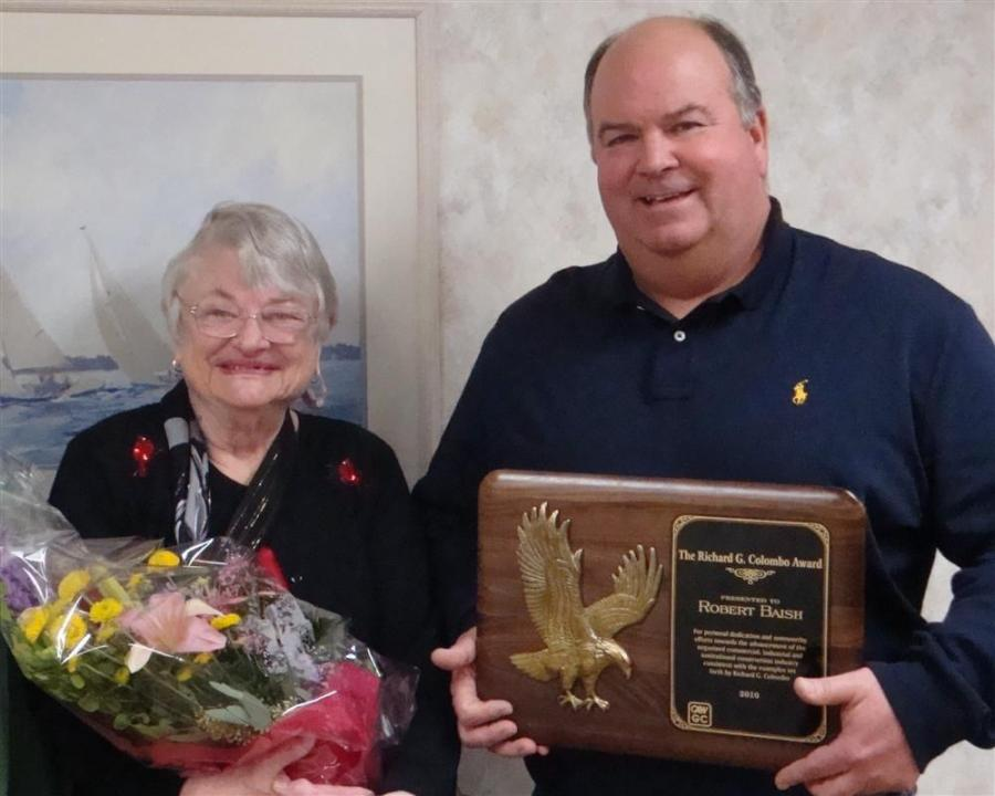 Margaret Colombo, widow of Richard G. Colombo, presented the award named after her husband to Bob Baish.