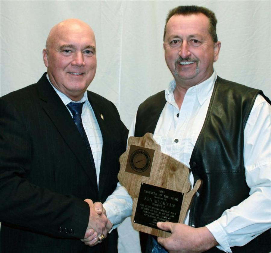 Ken Mulryan (R) receives his engineer of the year award from an International Union of Operating Engineers representative.
