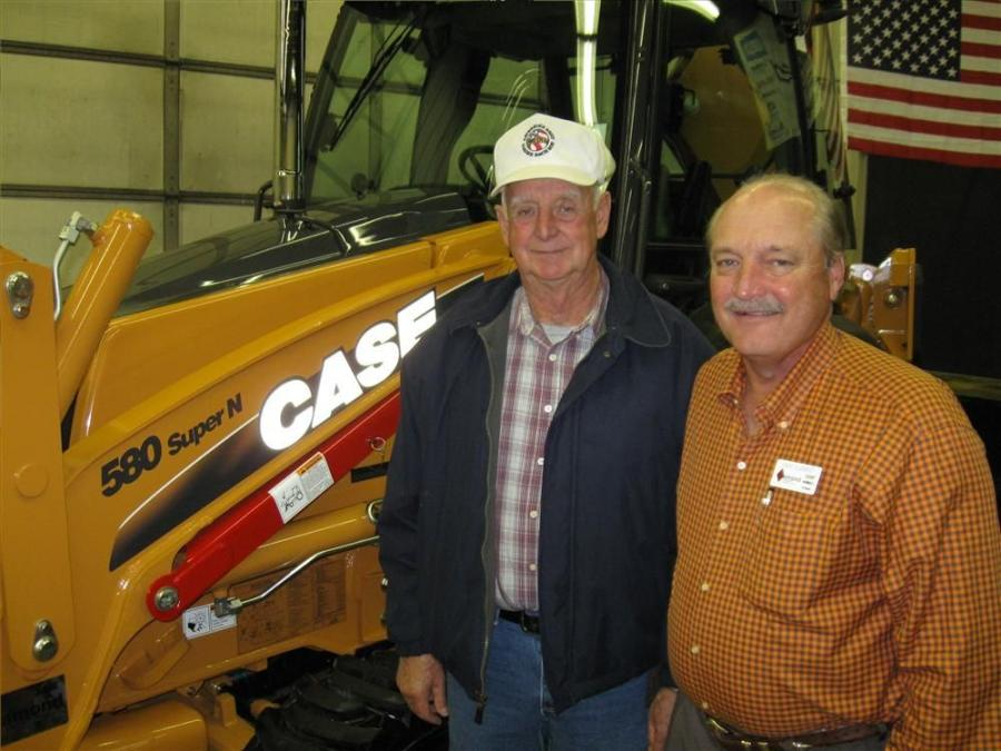 Irvan Ragan of Irvan Ragan Backhoe Services (L) receives a warm welcome and hearty thanks from Diamond Equipment's Dave Clement on the purchase of his 22nd backhoe.