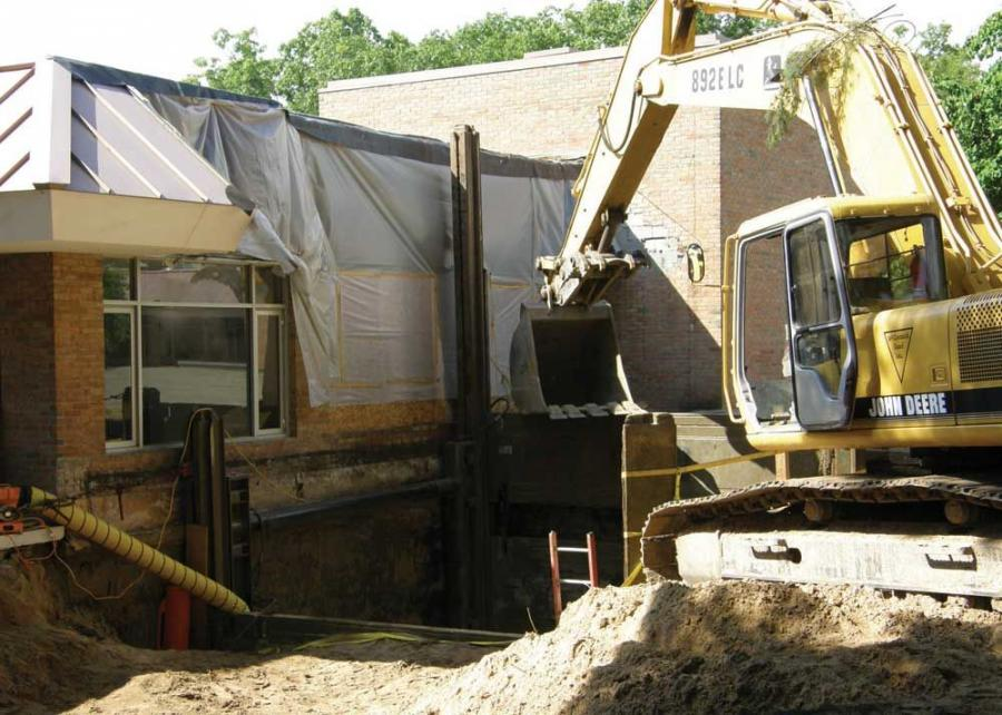 McCormick Sand Inc. took on the task of excavating and shoring a 28 ft. (8.5 m) deep pit, right along two sides of a building, in preparation of the casting-in-place a new elevator shaft.