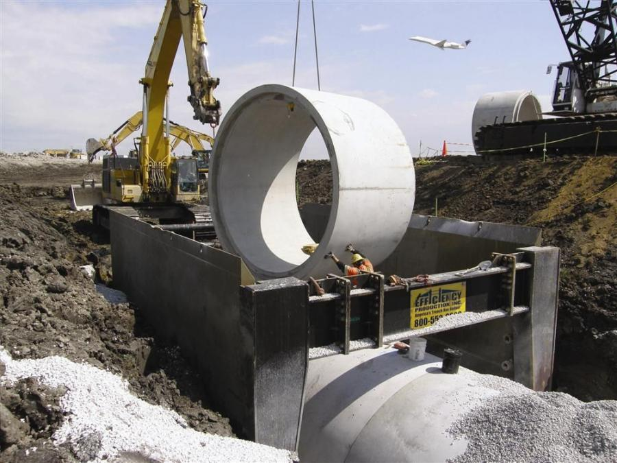 A total of 188 individual, 8 ft. (2.4 m) long, 12 ft. (3.6 m) diameter pipe sections were installed in the ground 25 ft. (7.6 m) below the future runway.