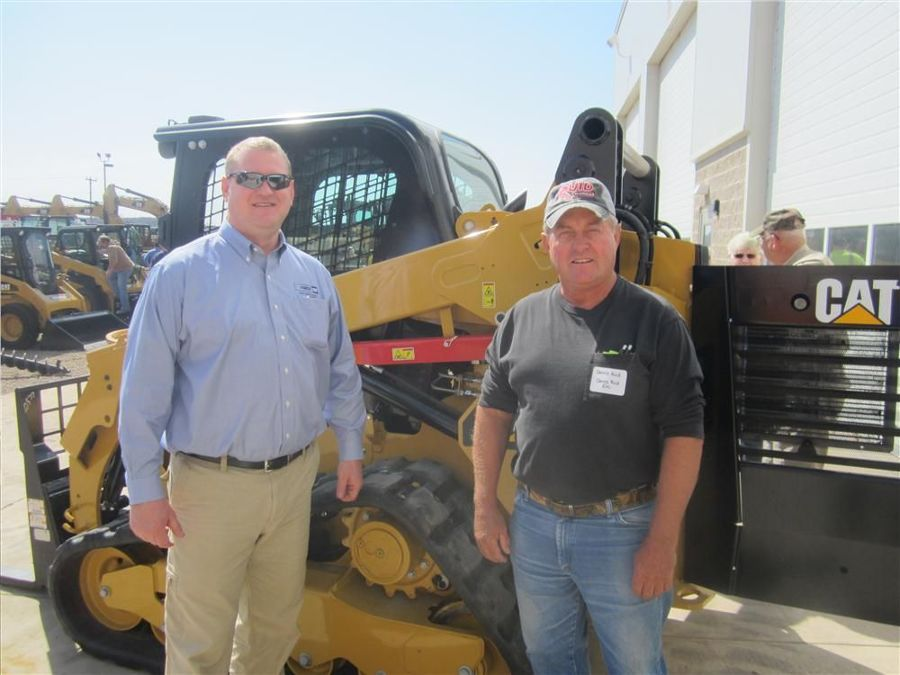 Loren LeGesse (L), FABCO Equipment Inc., answers questions about the Cat 259 skid steer from Dennis Ruid of Ruid Excavating.