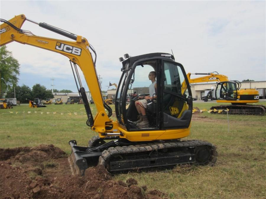 Getting some stick time in the JCB 8085 excavator is Jake Schuh of Landscape Construction Systems.
