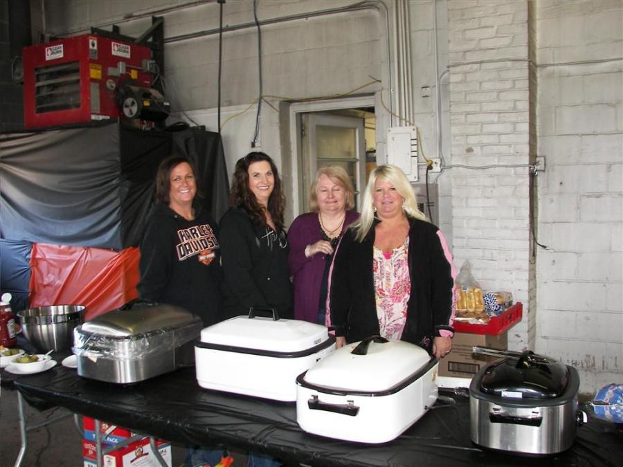(L-R): Shana Shuck, Lori Ebnet, Joyce Ronning and Cindi Sjobert serve a great lunch of hot dogs, brats and burgers with all the fixings.