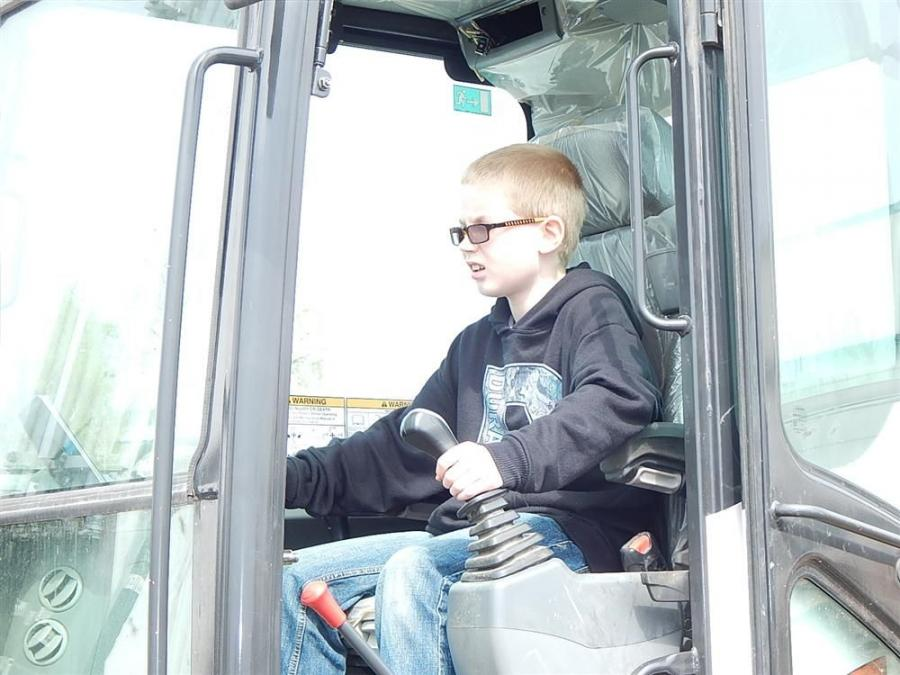Rilee Lang of Paynesville, Minn., checks out the Bobcat E85 excavator.