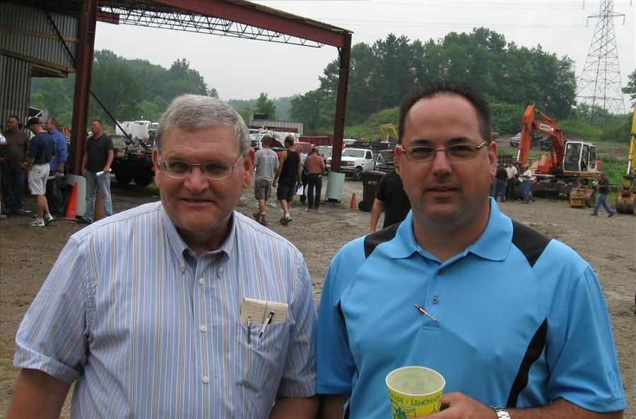 Skip Stewart (L) and Chad Schultz of Ohio Cat stop by to take in the auction activities.