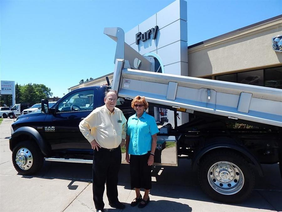 Dick Reinick, Fury Commercial Truck Sales, South St. Paul, Minn., and Truck Utilities's Wendy Laughter admire this Dodge 5500 with a Truck Utilities mounted dump box.