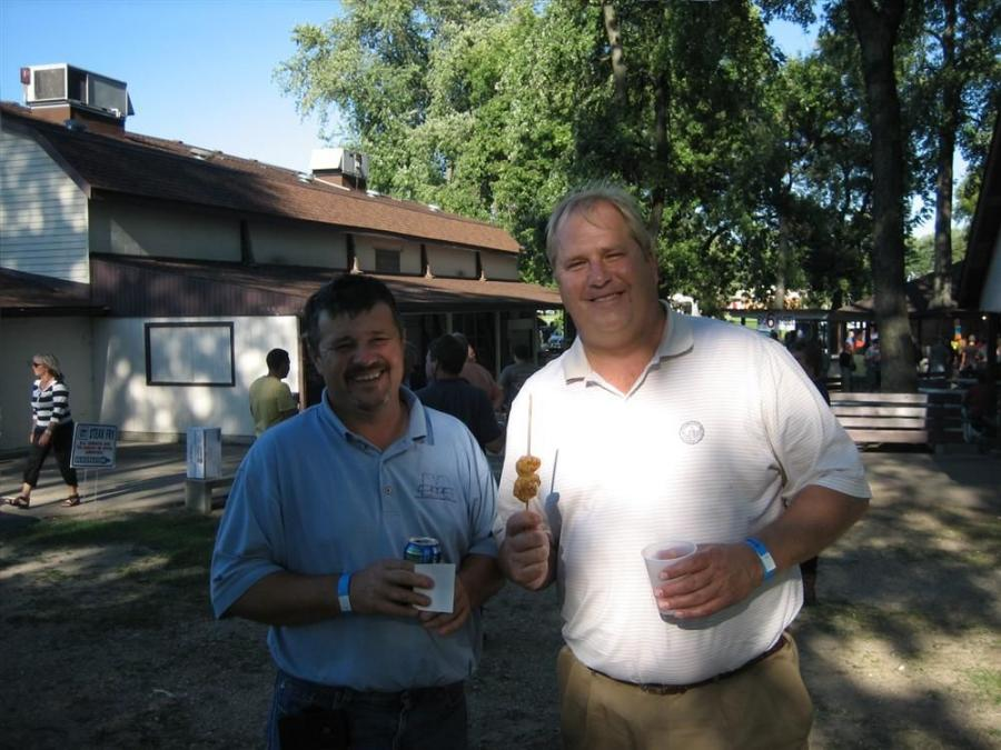 Enjoying some shrimp on a stick are Wes Stasica (L) and Dave Bergstrom, both of FCL Builders.