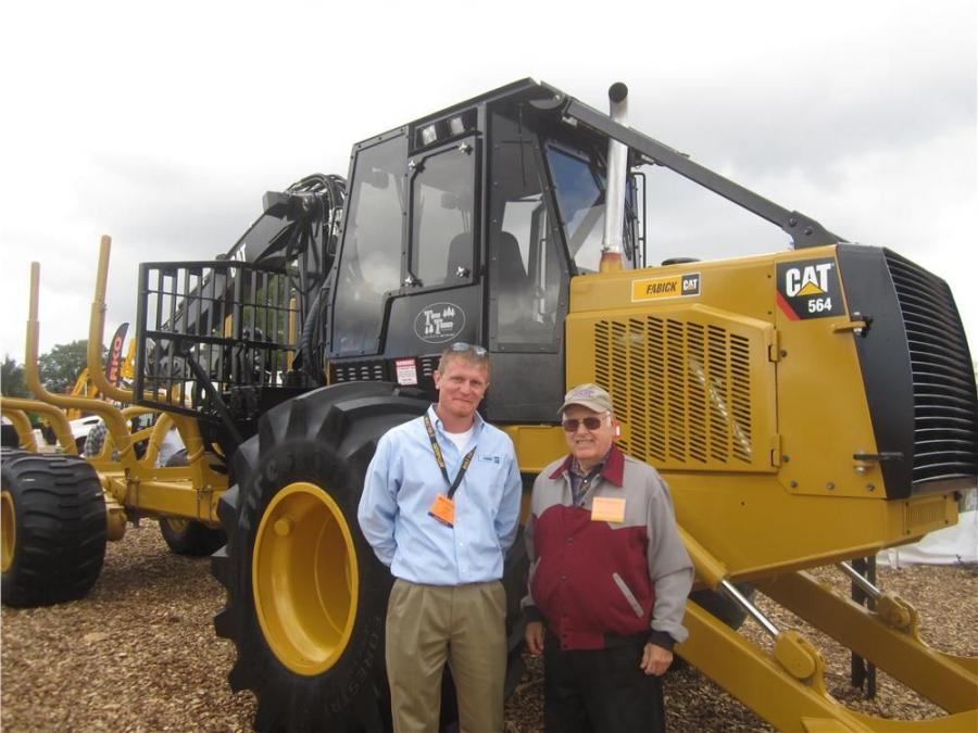 John Wery (L), Fabick CAT, shows the Cat 564 forwarder to Donald Casperson of Caseprson Brothers Logging.