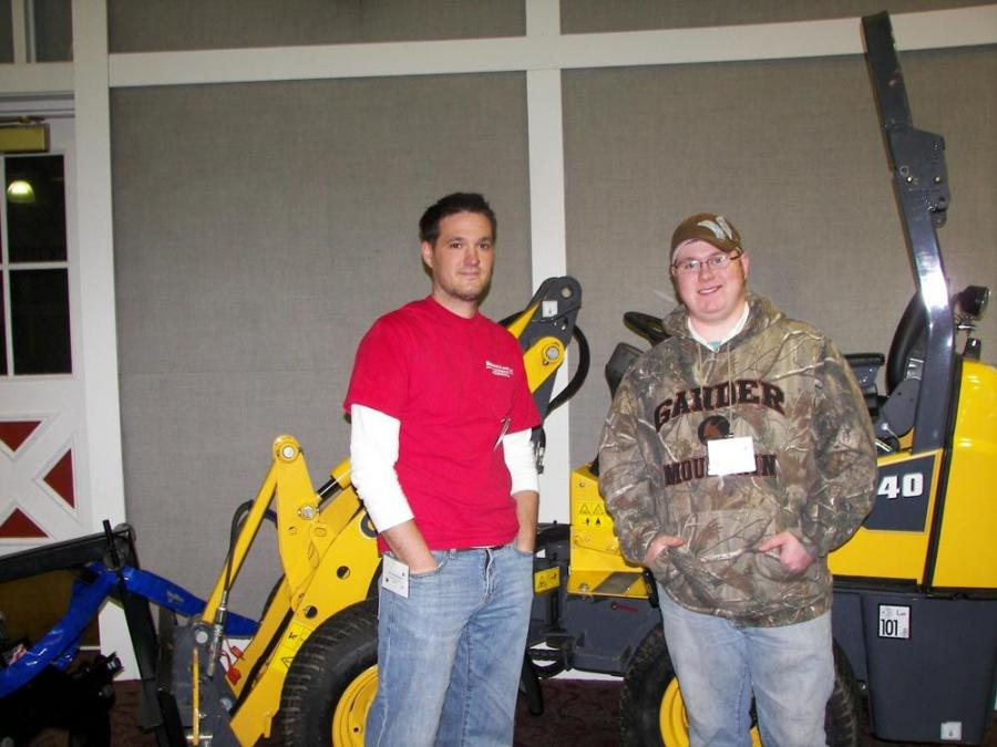 Dustin Breiwick (L), president of Top Notch Equipment of Plymouth, Minn., reviews the company's new equipment line by Gehl — in particular the AL140 articulated loader — with salesman Mike Berger.
