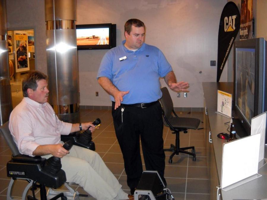 Caterpillar experts took time to show a range of tasks their equipment could accomplish inside the demonstration arena.