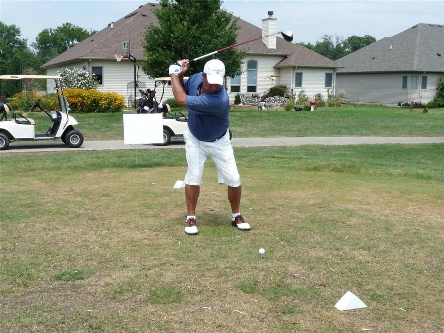 Pat Evett of S.E.S. Inc. in West Chicago, Ill., tees off.