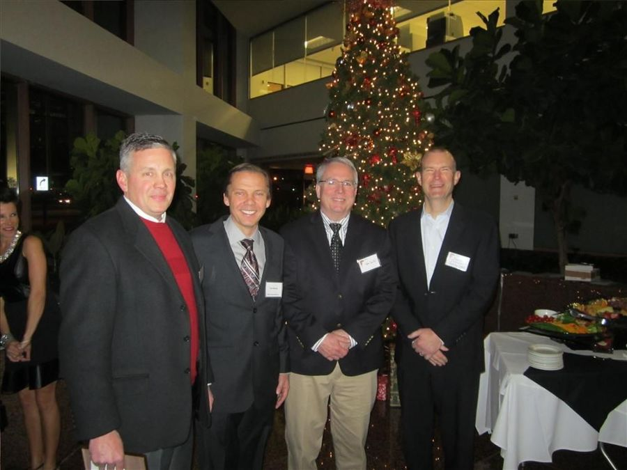 (L-R): 2013 IED President Robert Sloan passes the baton to new President Tom Novak of Martin Implement, Vice President Tom Smith of National Lift Truck and Treasurer Adam Tschetter of Patten Industries Inc. during IED's 47th Annual IED Christmas Reception