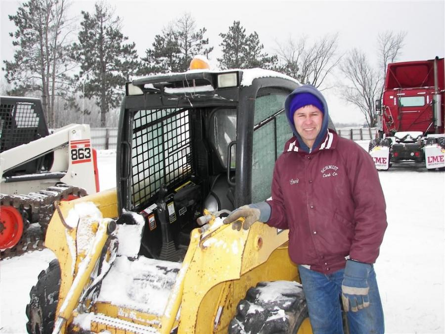 Ervin Hechtel of South Haven, Minn., takes a long look at this John Deere 320 skid steer.