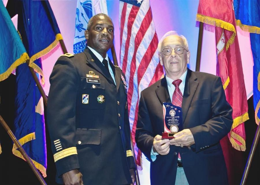 Brig. Gen. Darrel K. Williams (L), the DLA Land and Maritime Commanding General, presents David Baker, VP Product Support- Kirby-Smith Machinery, Inc., with the Silver Award.