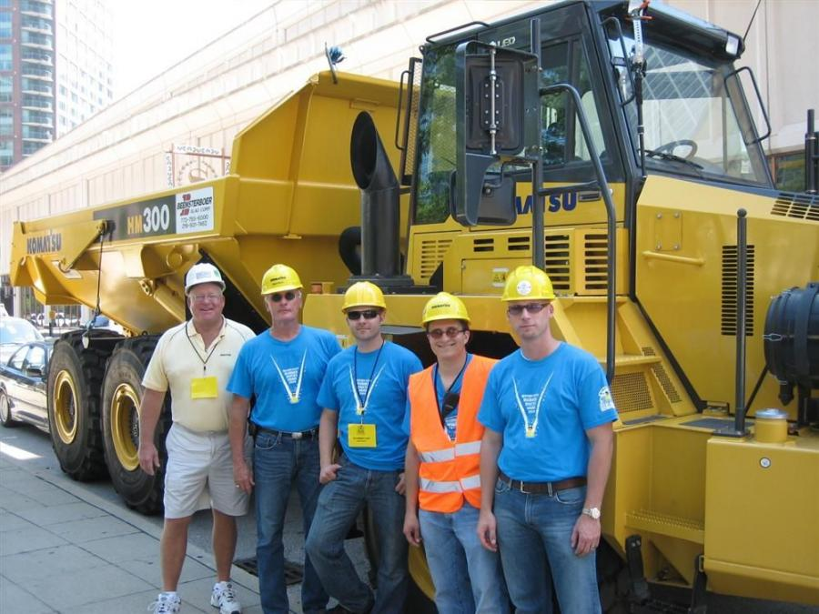 (L-R): in front of the Komatsu HM 300 articulated truck loaded with rubber ducks are Dave Cruise of Roland Machinery Co., and Steve Moore, James Phillips, Mike Gidaspow and Bill Westermann, all of Komatsu America Corp. One of the sponsors of the truck is
