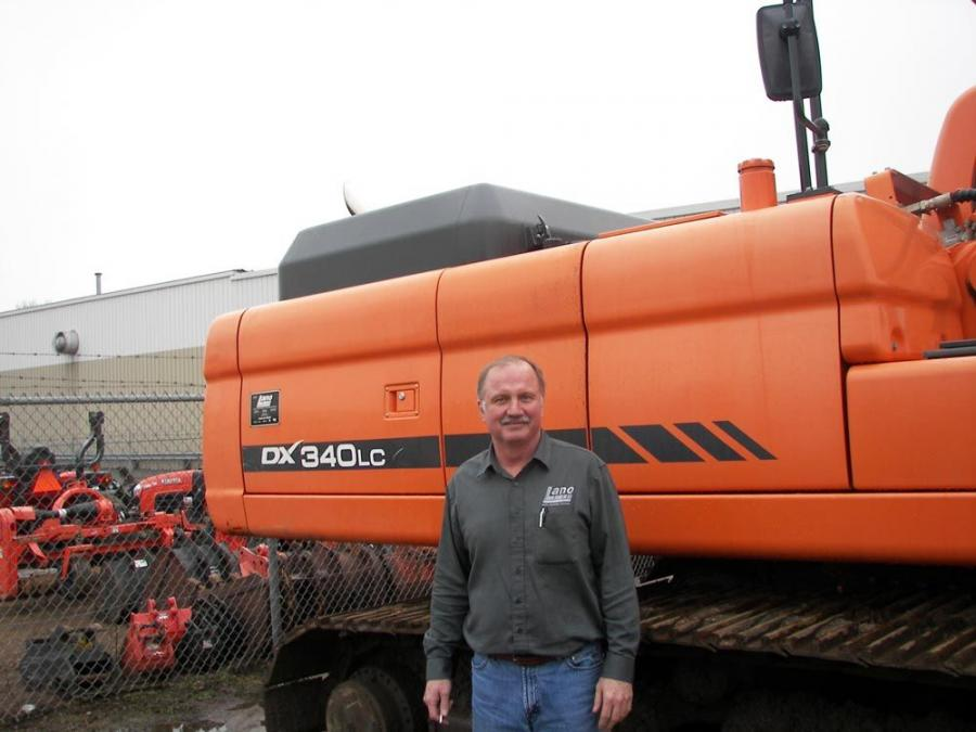 Brad Lano, owner of Lano Equipment Inc., was happy to pose with this Doosan DX340LC Excavator.
