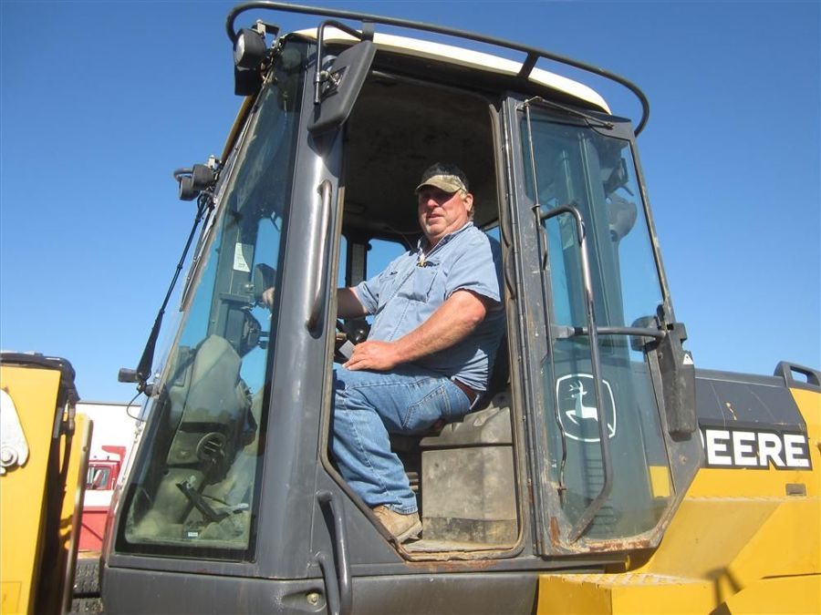 Scott Waite of Down to Earth Construction sits in the driver's seat of this John Deere 544K wheel loader.