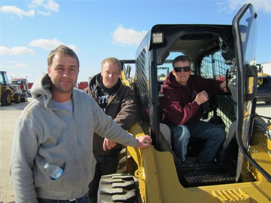 (L-R): Brothers Eddie, Brad and Robby Lindstrom of Lindstrom Lawncare and Landscaping hope to take this Cat 272 skid steer home.