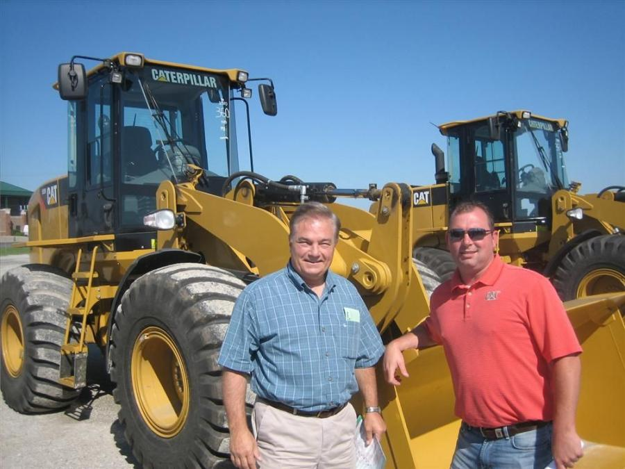 Dave Modglin (L), used equipment manager of Fabick CAT, and Fabick CAT Sales Representative Ted Haertling in front of a Cat 928 wheel loader.