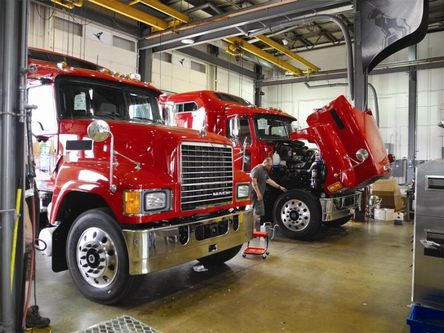 A Mod Center technician is checking a Mack Pinnacle tractor prior to delivery to its new owner.