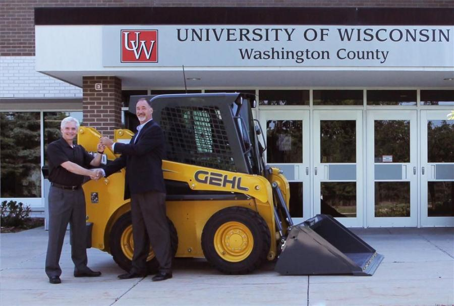 Dan Miller (R), CEO of Manitou Americas and president of the Manitou Group CE-compact equipment division, hands over the keys to a new Gehl R190 skid loader to UW-WC Campus Dean Paul Price.