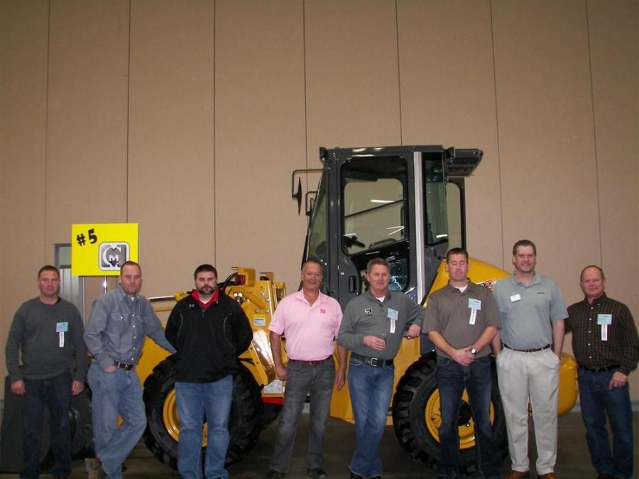 (L-R): Mid Country Machinery's Tim Plegge, Randy Reiners, Trent Cook, Mark Swedlund, Bud Pecoy and Lucas Peed, Kawasaki Products Representative Aaron Reichart, and Mid Country Machinery's Doug Miller meet and greet the attendees at the 100 yea