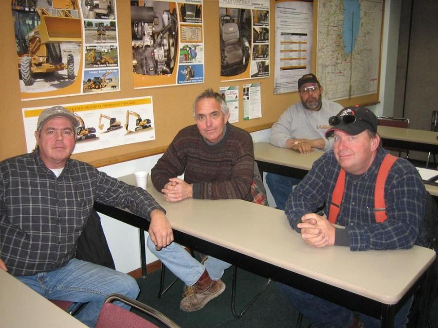 (L-R): Kevin Zupec of Campanella Excavating, Dick Day of DK Excavating, Bill Williams of J.S. Riemer Site Contractor and Carl Chrisenson, also of DK Excavating, discuss the emissions requirements for the Tier IV engines.