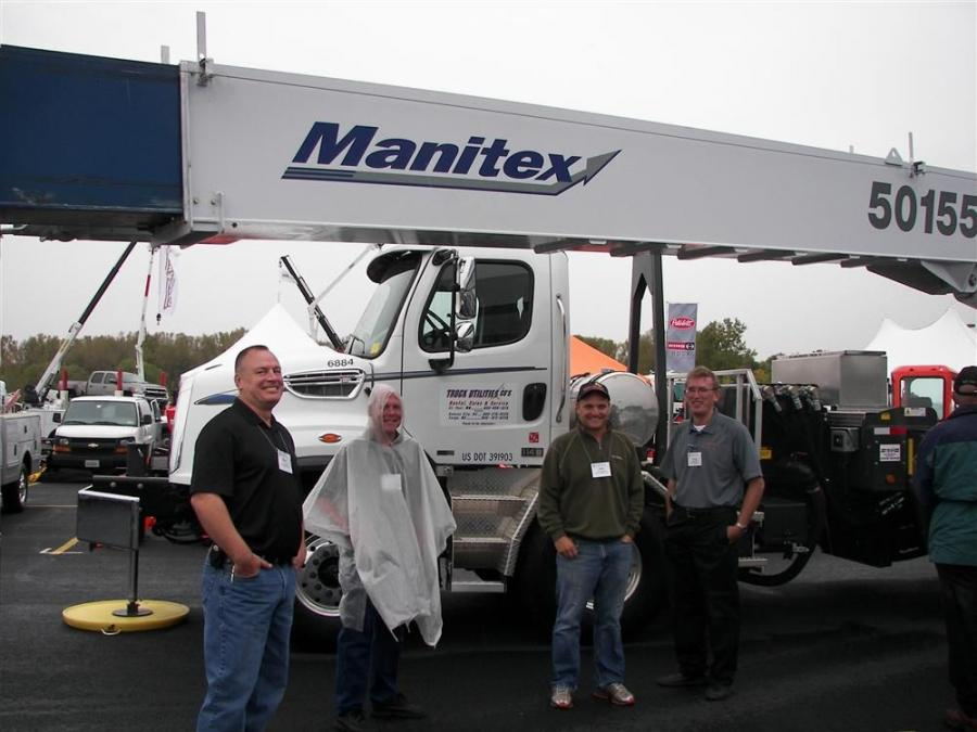(L-R): Terry Hoops, sales, of Truck Utilities, St. Paul, Minn.; Dave Murphy of Prairie Equipment, Eden Prairie Minn.; and Rob Streeter and Craig Capeder stand with a Manitex truck-mounted 50155S crane at the 2012 MEGA Utility Equipment Expo.