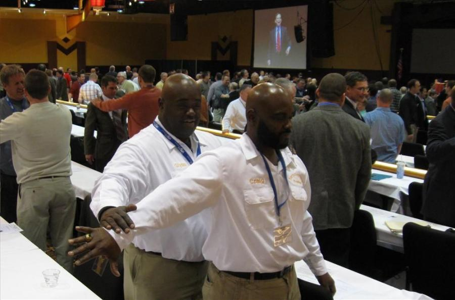 Brothers Glynn (L) and Craig Robinson of Rock 'n Rubble try an exercise in telekinesis during the keynote address by Dr. Teplitz.
