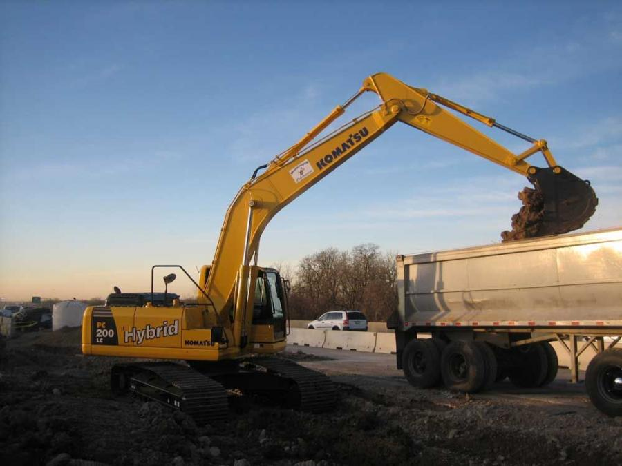 The first dirt is moved by the Komatsu PC200LC-8 hybrid excavator from Roland Machinery Co.