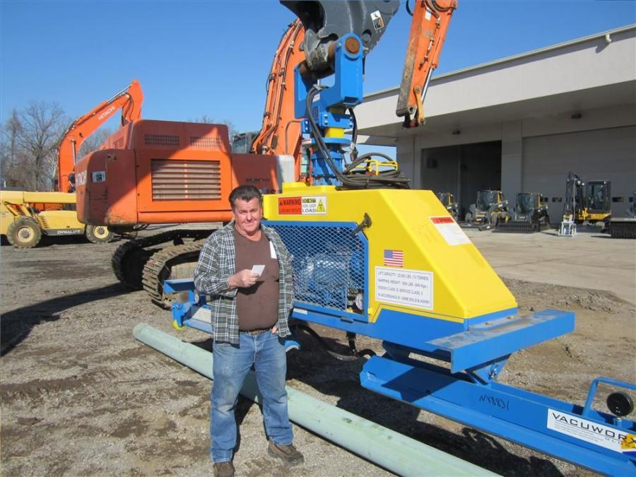 John Tish, InfraSource Underground, looks over the Vacuworx rc10 attachment.