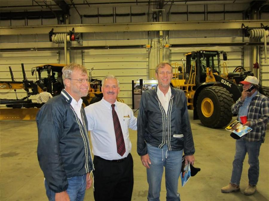 Arlin Toews (L) and brother, Verlin (R), visit with Dale Mickle of the ALLU Group Inc.