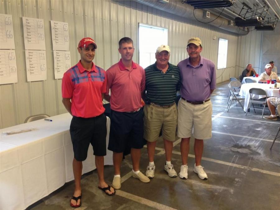 (L-R): Ryan Strength, Tim McBride, Jim Smith and Bruce Lyon, all of Affordable Mini-Storage LLC, win first place.