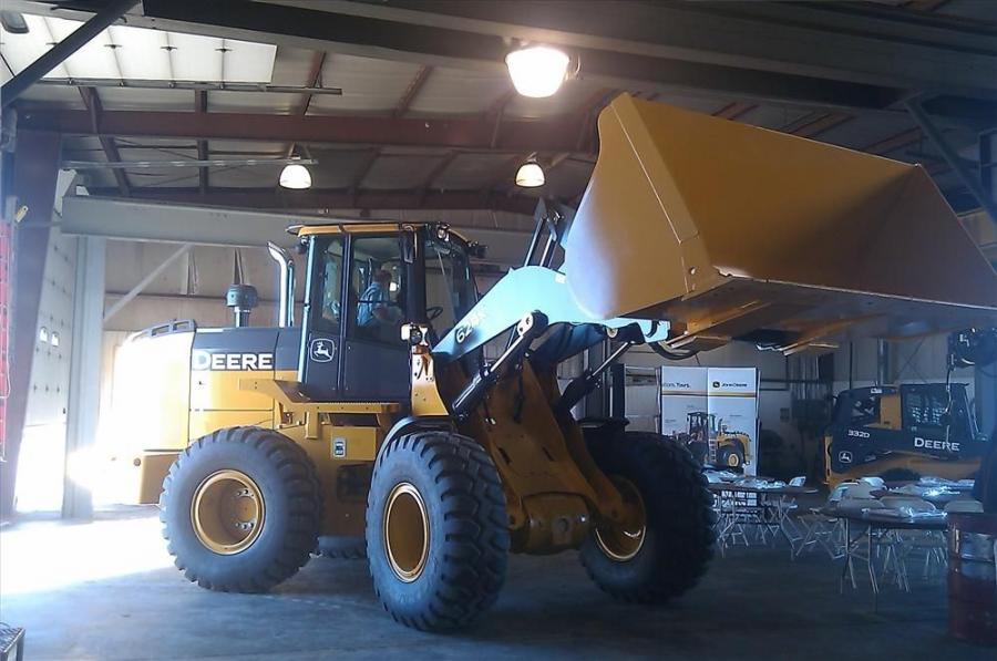 A customer sits in the cab of the John Deere 624K to get a feel for what it's like behind the wheel loader's controls.