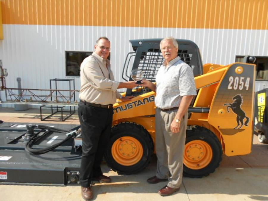 Bruce Bowman (L) receives Top Dealer Award from Jack Sabers of Mustang.