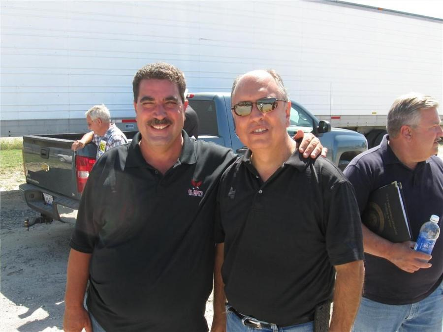 Phil Sakalian (L) of Fiori Enterprises catches up with Frank DiPonio of DiPonio Contracting during the sale.