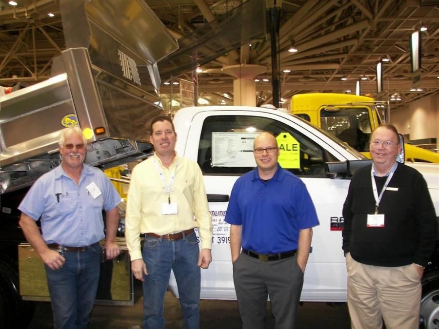 (L-R): Bob Anderson of the Osseo School District checks out this 4500 Dodge Ram with a 9-ft. rugby aluminum body from Fury Motors, South St. Paul, Minn., at the Truck Utilities booth with Charlie Miller, sales OF Truck Utilities, St. Paul, Minn.; Regional