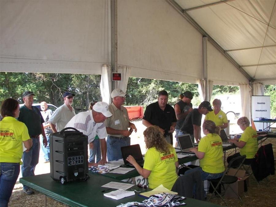 Attendees of the first annual LICA Nebraska Construction Expo & Field Day register and pick up their badges.