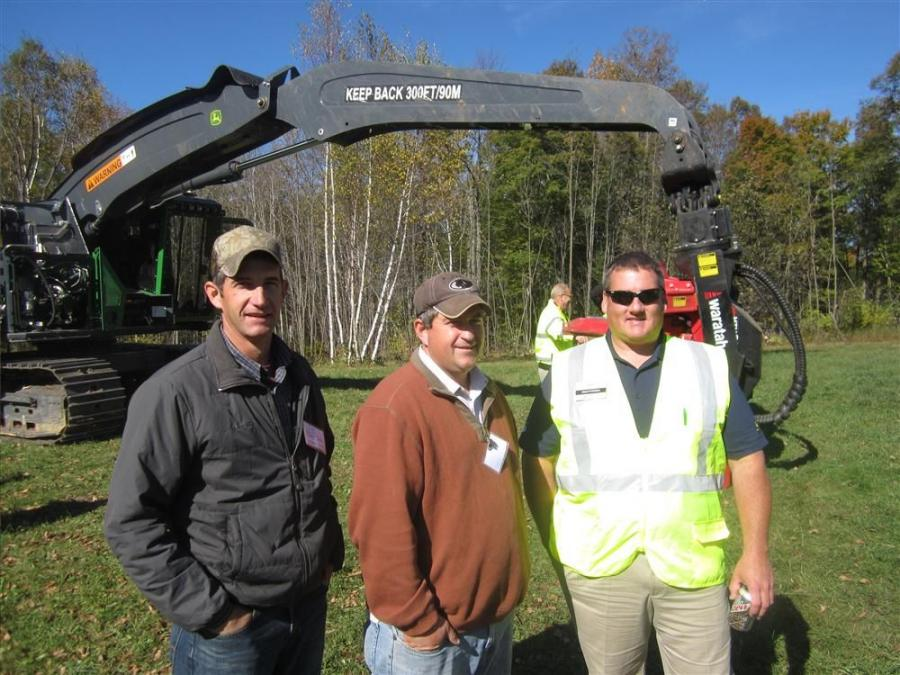 (L-R): Dwight and Luis Yoder and Jason Whitaker of Nortrax in front of the John Deere 803MH with Waratah 622B head.