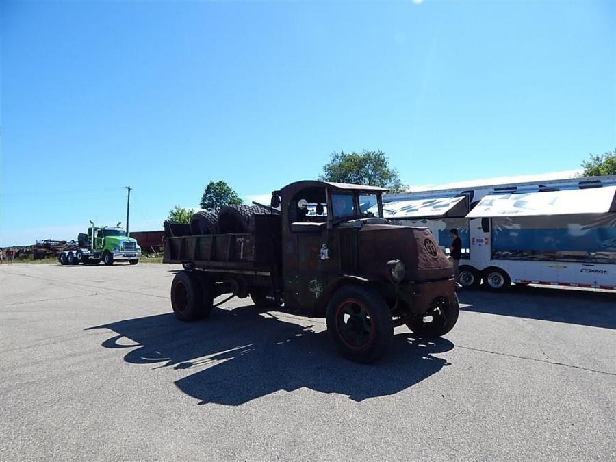Chad Eibensteiner, Lowboy driver of Nuss Truck & Equipment, takes this antique truck for a ride.