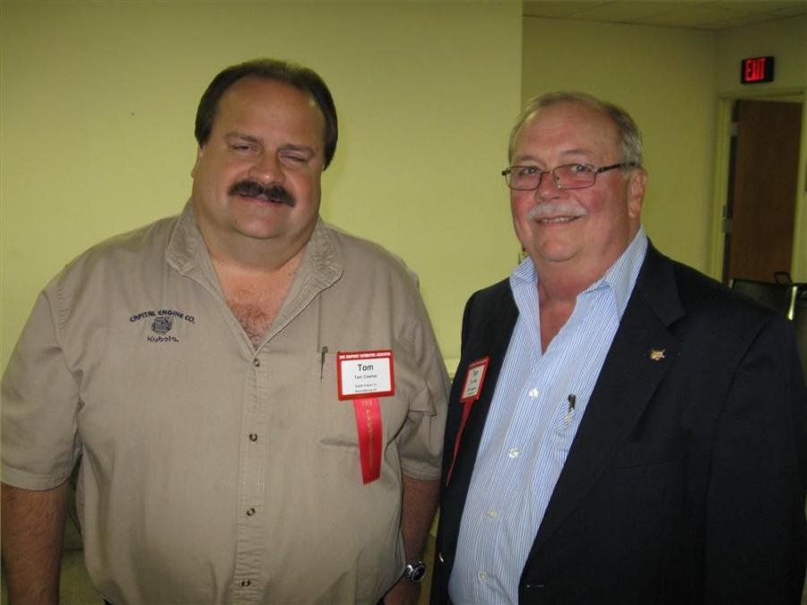Capitol Engine Company's Tom Cowher (L) talks with Bobcat Enterprises President Tom Trapp.