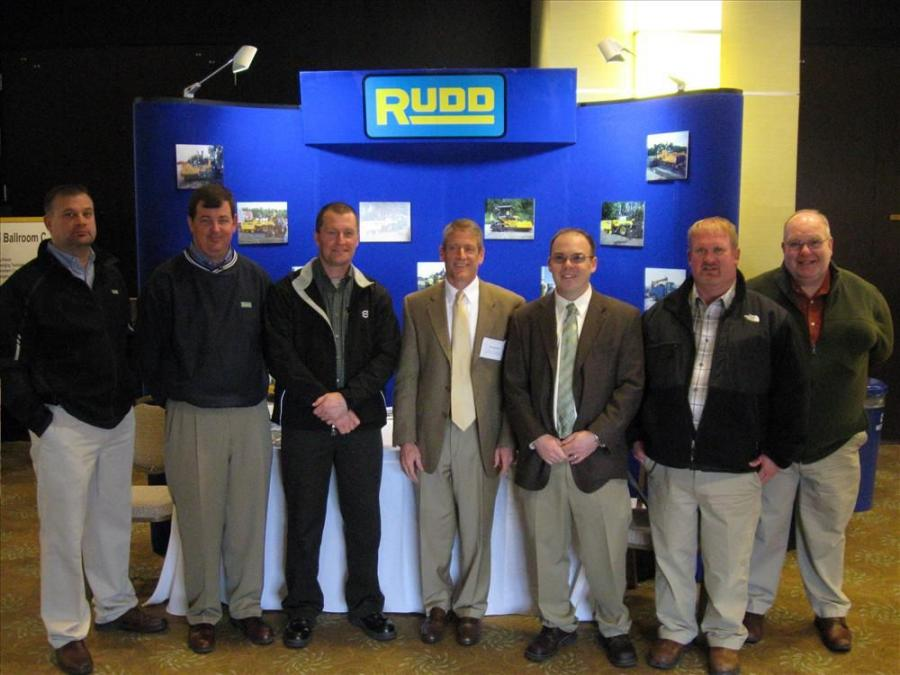 (L-R): Rudd Equipment Company's Mark Tanzillo, Jamie Terrill, Tim Menke, Martin McCutcheon, Dave Bencze and Josh Poston, and Volvo's Andy Capps welcome Ohio Asphalt Expo attendees.