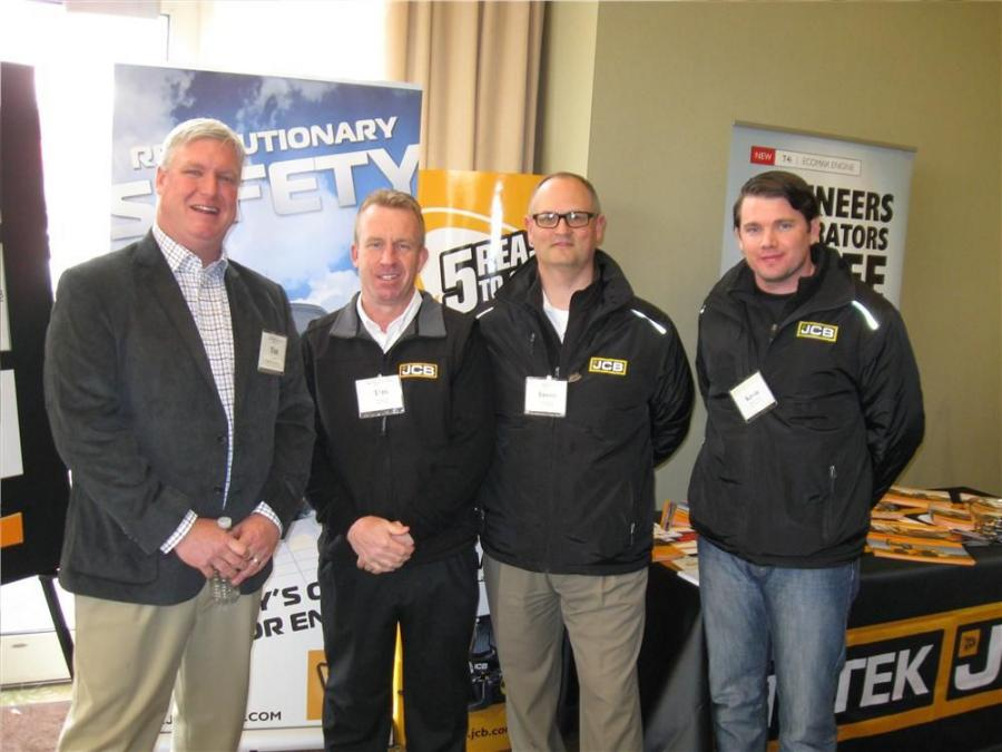 (L-R): At the JCB display, Ritchie Bros. Tim Keane talks with JCB Compaction Business Manager Tim Spring, Hy-Tek JCB's Jason Milligan and Kevin Ray of Burns JCP.