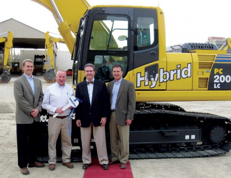 (L-R): Eric Wilde, Komatsu America Corp.'s vice president of product marketing, presents Dick Brannigan, John R. Jurgensen Companies' equipment operations manager with the keys to the new Hybrid PC200LC-8 excavator with the assistance of Colum